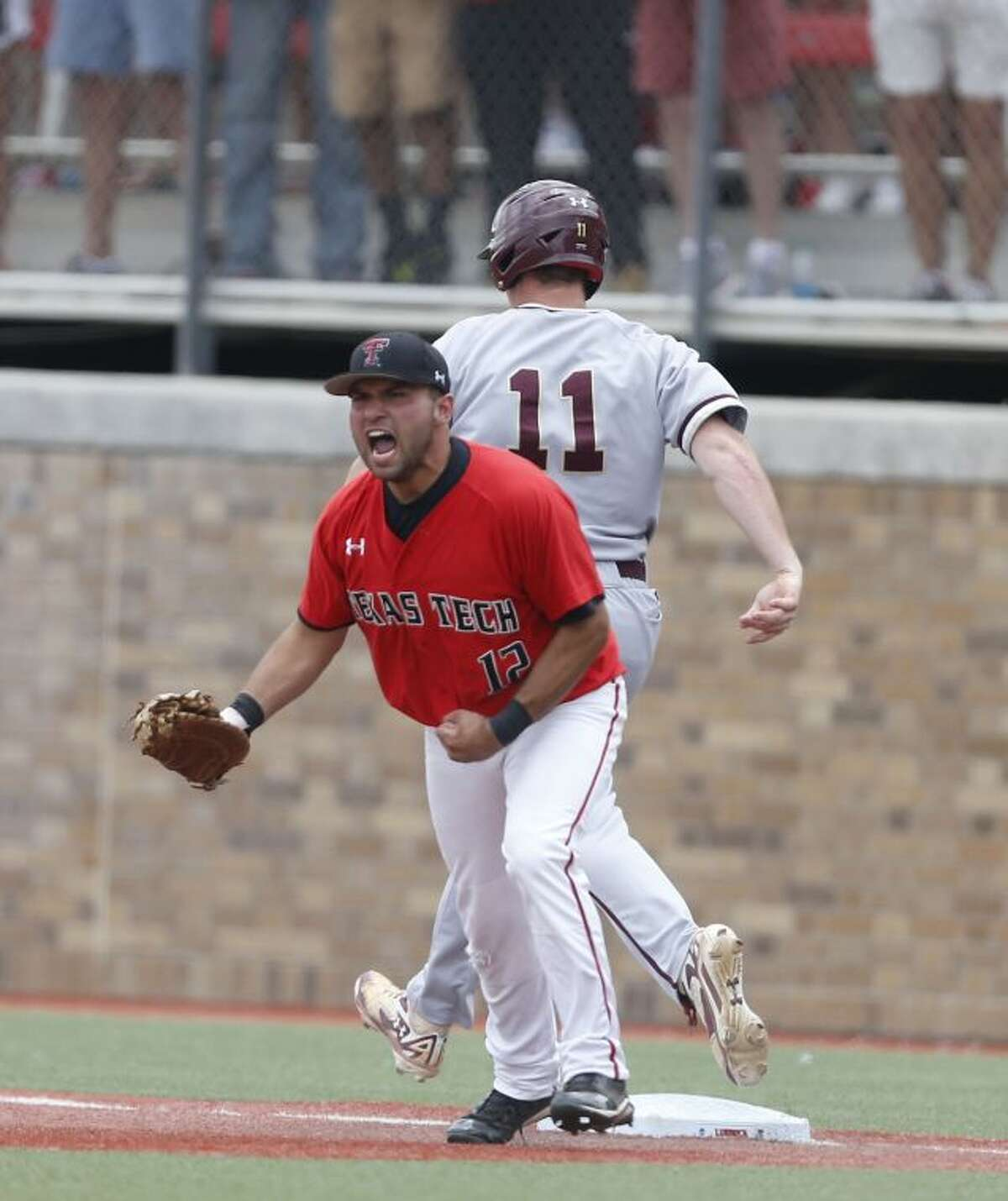 Texas Tech's Eric Gutierrez(12) celebrates the final out on College of Charleston's Nick Pappas during an NCAA college baseball tournament super regional game in Lubbock, Texas, Saturday, June 7, 2014. Texas Tech won 1-0. (AP Photo/Lubbock Avalanche Journal,Shannon Wilson)