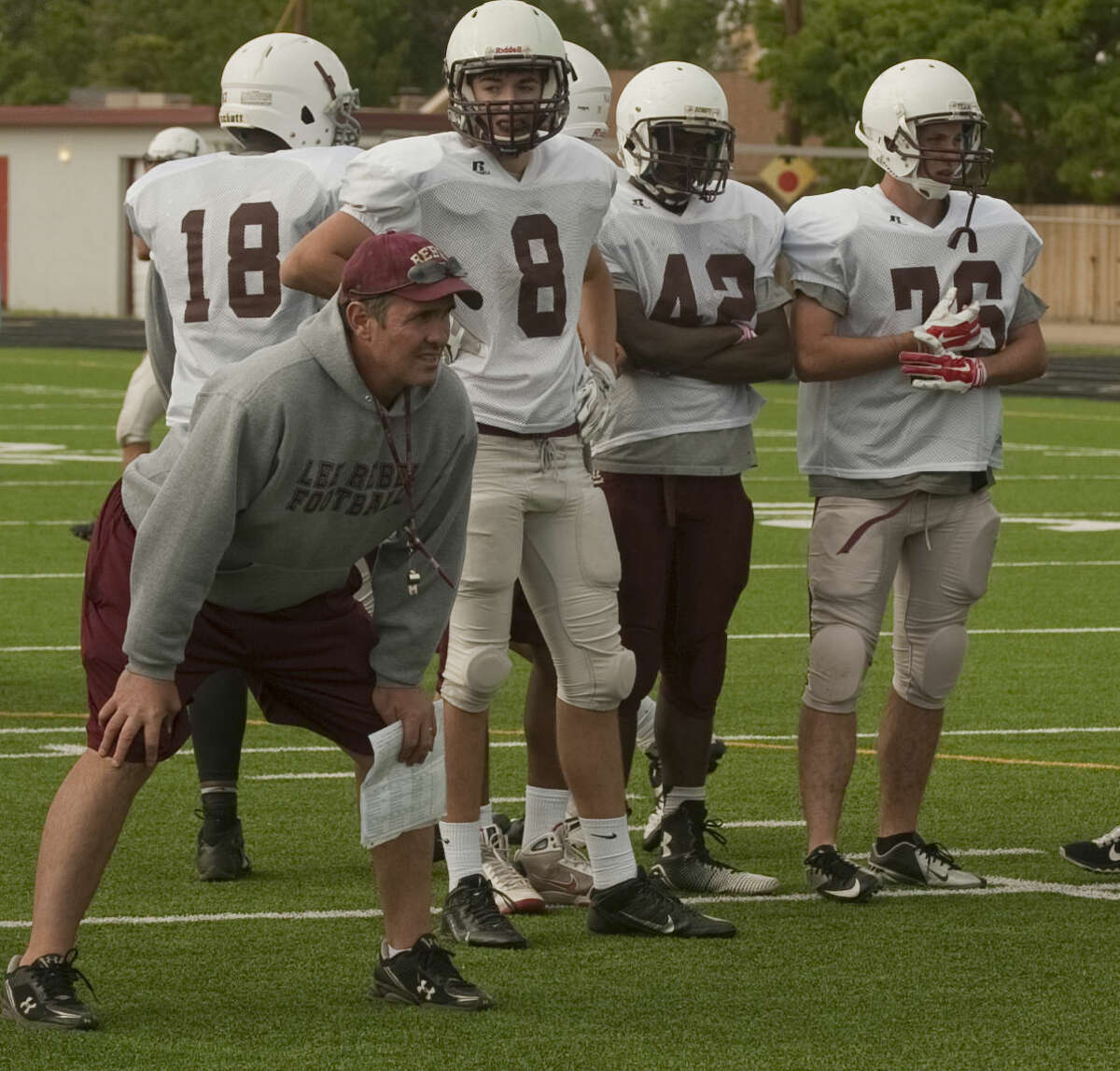 Lee head coach James Morton watches his players run drills Monday, 4-27-15, during the first day of spring practice. Tim Fischer\Reporter-Telegram