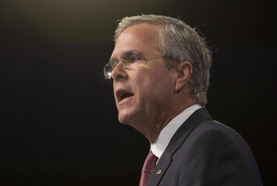 In this photo taken July 31, 2015, Republican presidential candidate, former Florida Gov. Jeb Bush speak in Fort Lauderdale, Fla. Ten Republican presidential hopefuls face off in the first prime-time debate of the 2016 campaign Thursday night in a clash that marks a big step forward in their quest for the nomination. (AP Photo/Wilfredo Lee) Photo: Wilfredo Lee
