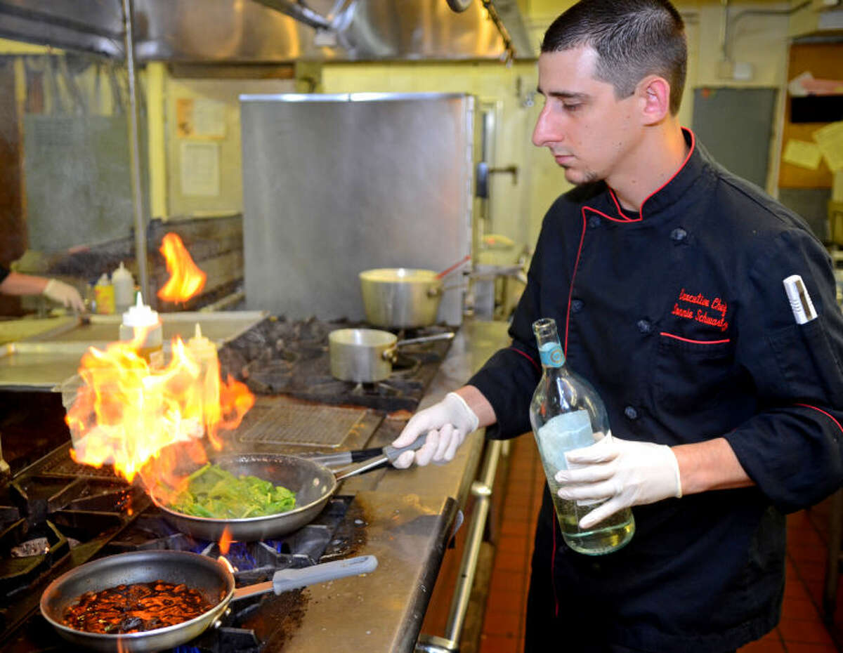 """Donnie Schwartz, executive chef at Ranchland Hills Country Club, prepares a bechamel creamed spinach sauce as part of a signature filet mignon entree Thursday in the Ranchland Hills kitchen. """"I want Midland and Odessa to know that good food is right in their backyard,"""" said Schwartz, """"they don't have to go out of town."""" James Durbin/Reporter-Telegram"""