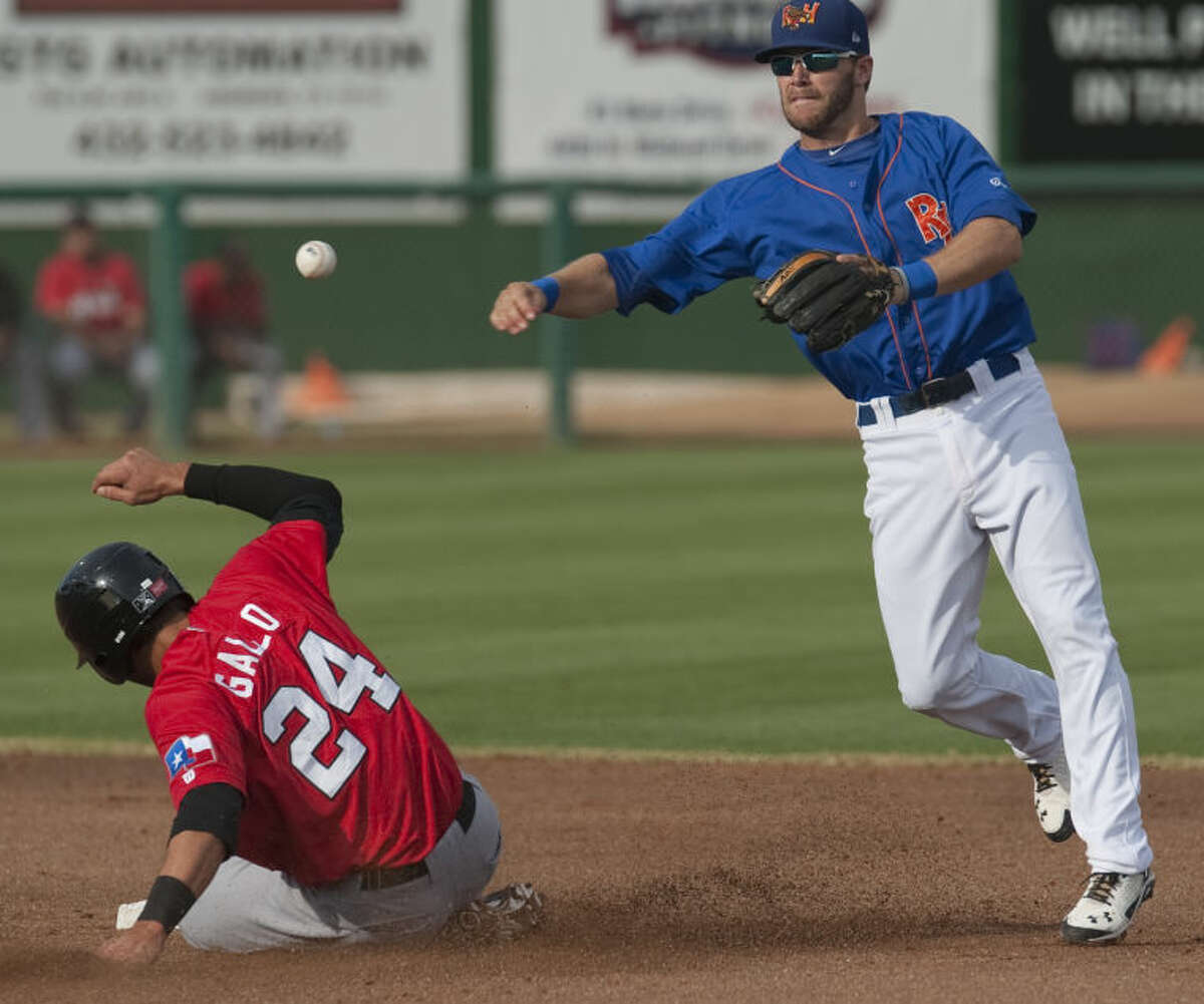 RockHounds' Dusty Coleman gets the force out at second on RoughRiders' Joey Gallo but can not complete the double play to first Monday evening at Security Bank Ballpark. Tim Fischer\Reporter-Telegram