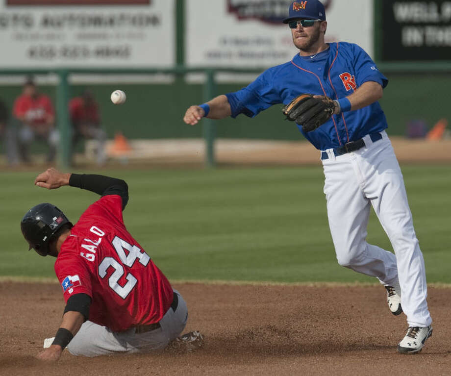 RockHounds' Dusty Coleman gets the force out at second on RoughRiders' Joey Gallo but can not complete the double play to first Monday evening at Security Bank Ballpark. Tim Fischer\Reporter-Telegram Photo: Tim Fischer