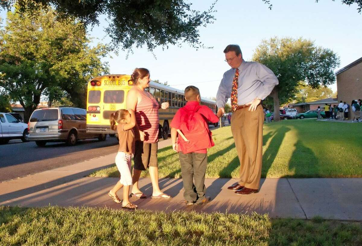 MISD Superintendent Ryder Warren, right, greets parents and students as they arrive on campus for a first day of school.