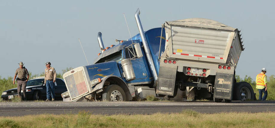 A jackknifed 18-wheeler on Interstate 20 led to the closing of the highway between FM 1788 and East Loop 338 Wednesday morning. Another crash on the highway added to the traffic congestion. Photo: Mark Sterkel|Odessa American