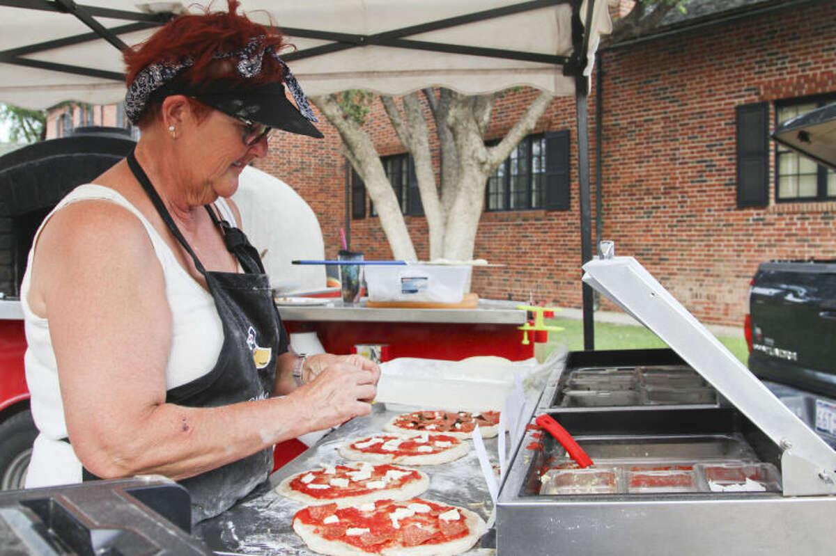 In this 2014 file photo, Teri Kilani cooks up a round of pizzas during the Summer Sunday Lawn Concert series held at the Museum of the Southwest. Tyler White/Reporter-Telegram