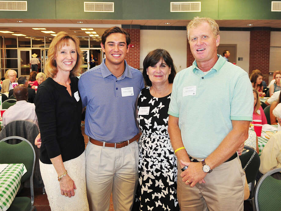 From left, Danna Gallegos poses with her son Patrick Wayland Memorial Scholarship recipient Matthew Gallegos and Carole and David Wayland.  Photo: Courtesy Photo