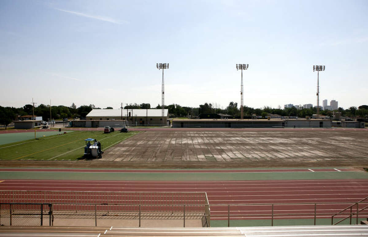 Workers pull up the turf at Memorial Stadium on Tuesday. James Durbin/Reporter-Telegram