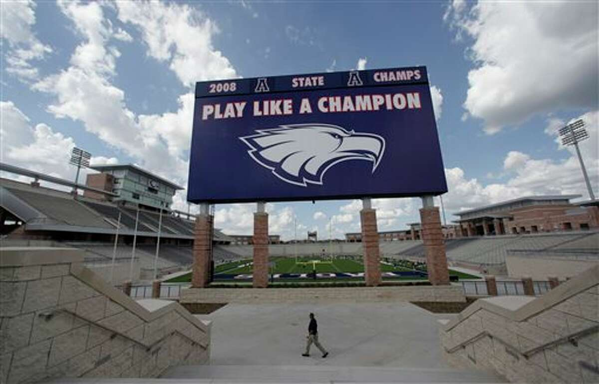 FILE - In this Aug. 28, 2012 file photo, the scoreboard is shown at Eagle Stadium at Allen High School in Allen, Texas. The $60 million high school football stadium that opened to massive fanfare in 2012 will be shut down for the upcoming season after cracks were found in the building's concrete concourse. (AP Photo/LM Otero)