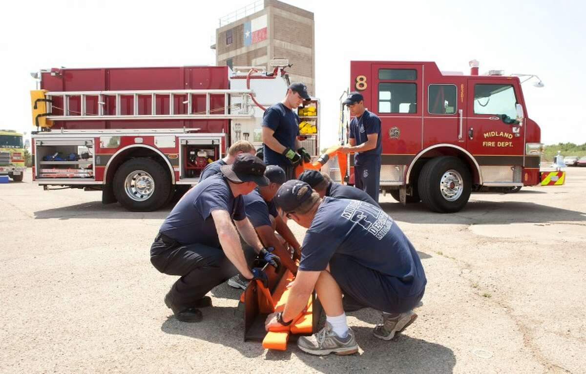 (File Photo) Midland Fire Department personnel familiarize themselves with the equipment on the new Station 8 fire engine at the MFD training grounds in this June 2011 file photo. Cindeka Nealy/Reporter-Telegram