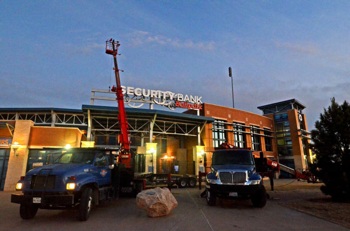 Workmen hang parts of the new sign in front of Security Bank Ballpark on Tuesday. James Durbin/Reporter-Telegram