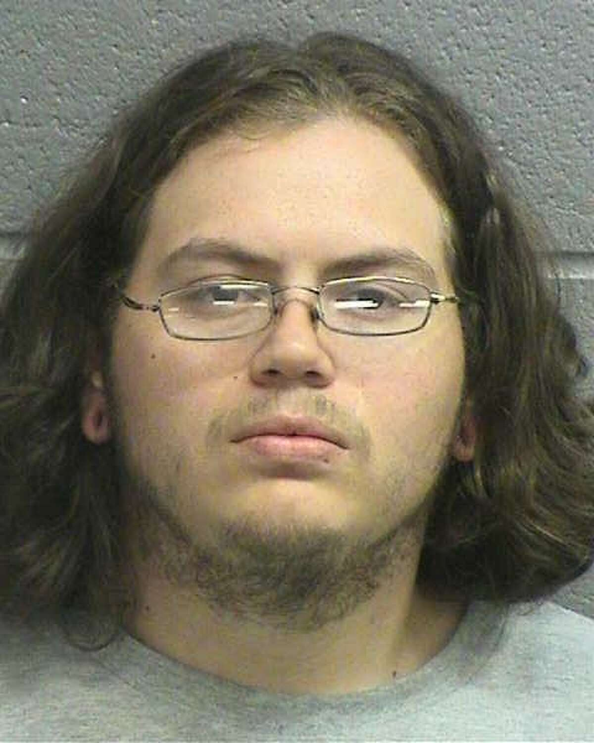 """Christopher W. Gollihar, 27, of Midland, was charged June 18 with a first-degree felony charge of burglary of a habitation with the intention to commit other felonies.Gollihar illegally entered a woman's Midland College dorm and assaulted a naked man in the dorm. The men fought briefly before Gollihar said """"truce"""" and left the dorm, according to the arrest affidavit.If convicted, he could face between five and 99 years in prison."""