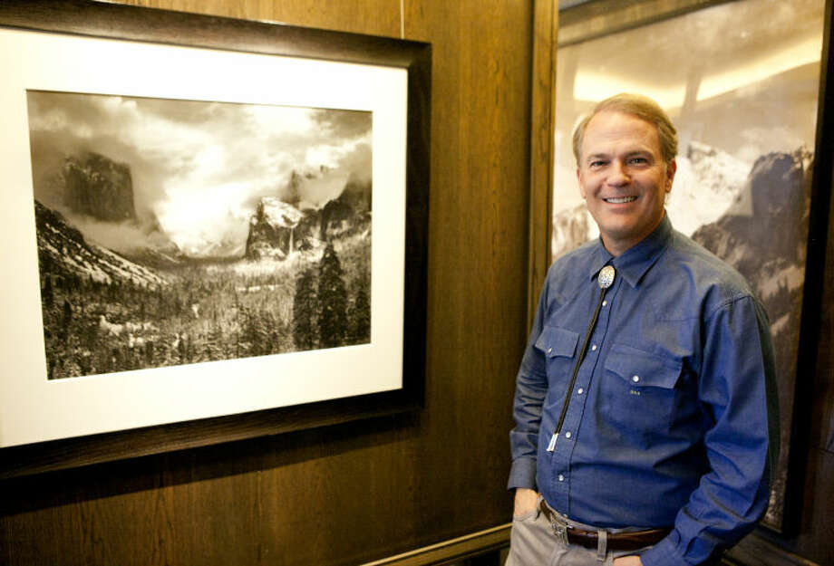 Midland oilman David Arrington, seen March 28, 2014, has an extensive collection of Ansel Adams prints in his downtown office. More than 100 photographs from his 650-photo collection will be auctioned off in December. Photo: James Durbin