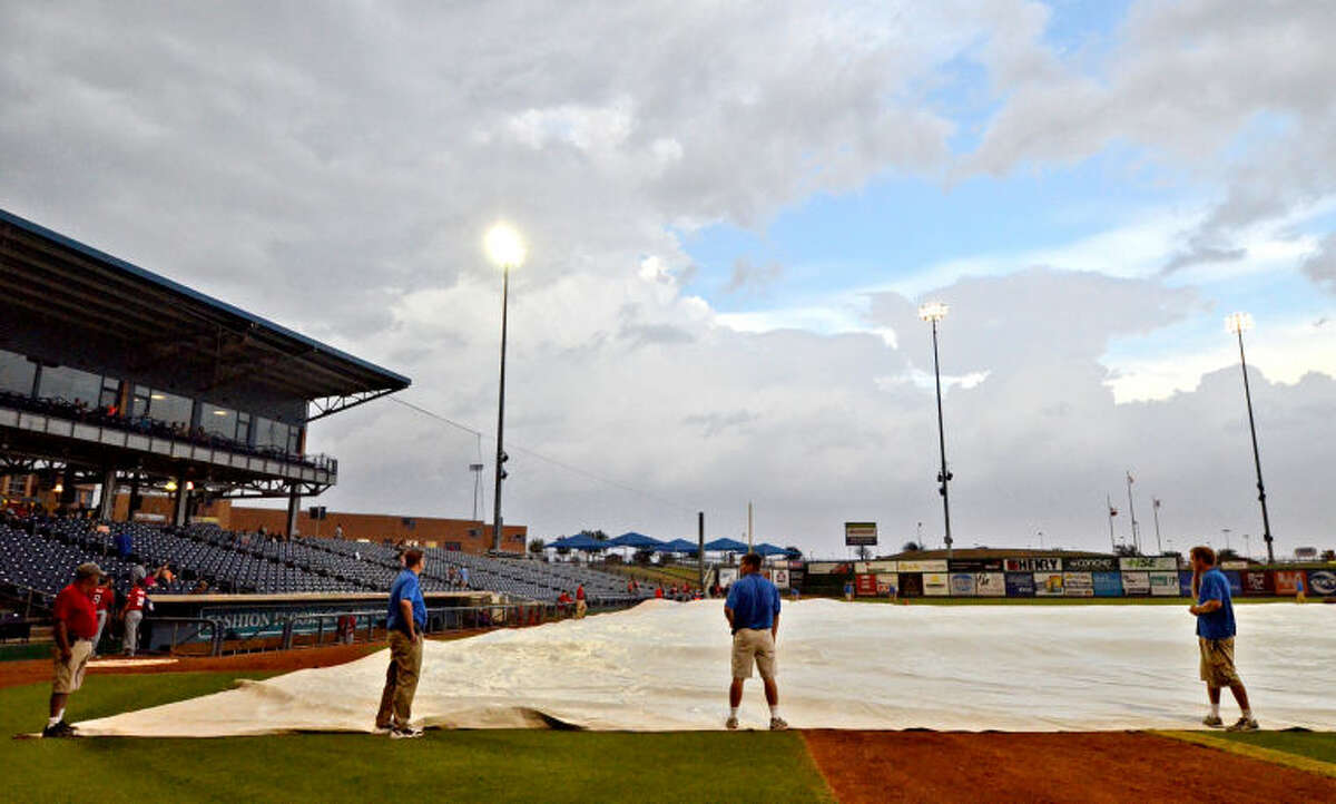 RockHounds employees cover the field at Security Bank Ballpark in preparation for a thunderstorm that swept through Midland and cancelled the game against Frisco on Wednesday. James Durbin/Reporter-Telegram