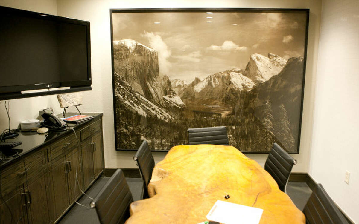 Midland oilman David Arrington has an extensive collection of Ansel Adams prints in his downtown office. More than 100 photographs from his 650-photo collection will be auctioned off in December.
