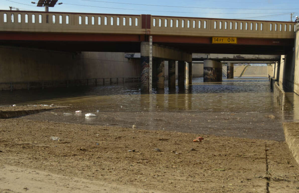 Debris clogged the drains in the Big Spring underpass at Highway 80 Wednesday night, leaving the roads closed Thursday morning with standing water more than two feet deep. Tim Fischer\Reporter-Telegram