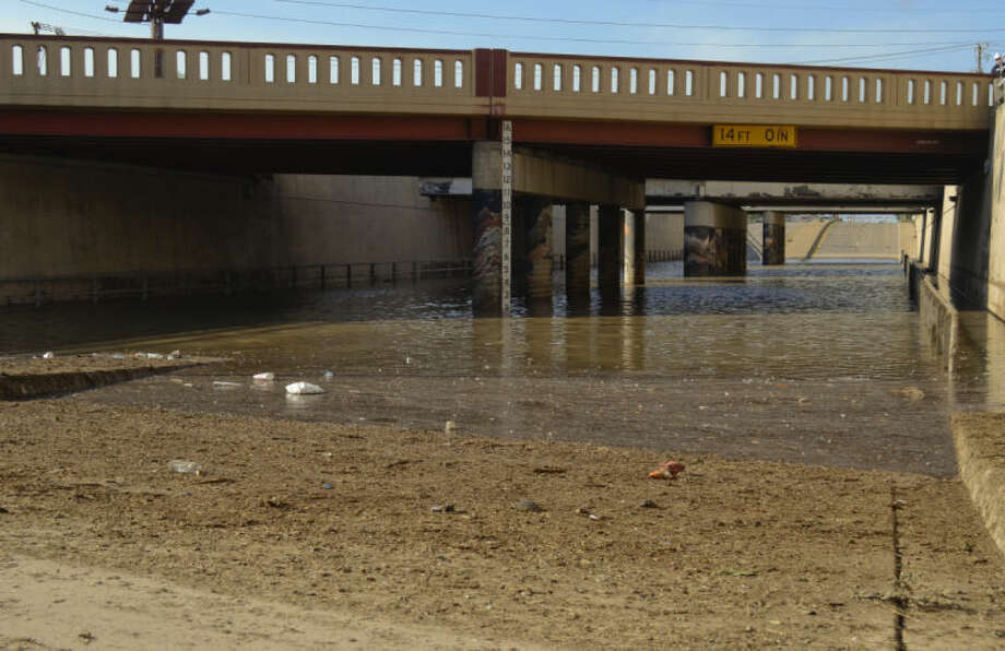 Debris clogged the drains in the Big Spring underpass at Highway 80 Wednesday night, leaving the roads closed Thursday morning with standing water more than two feet deep. Tim Fischer\Reporter-Telegram Photo: Photographer