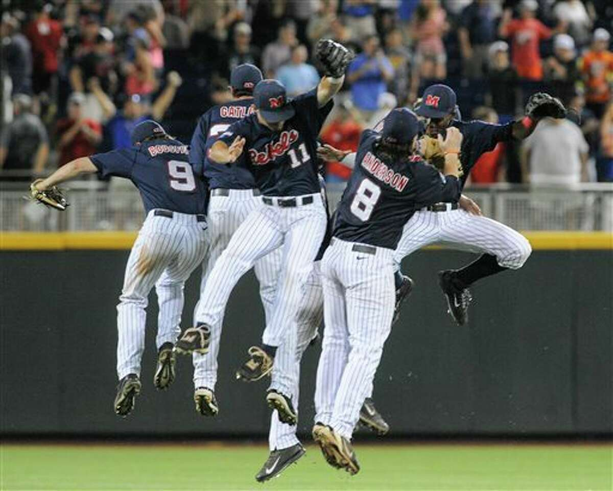 Mississippi players celebrate their 6-4 win over TCU in an NCAA baseball College World Series elimination game in Omaha, Neb., Thursday, June 19, 2014. (AP Photo/Eric Francis)