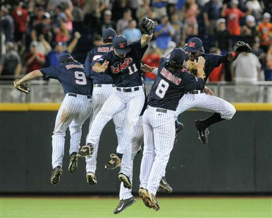 Mississippi players celebrate their 6-4 win over TCU in an NCAA baseball College World Series elimination game in Omaha, Neb., Thursday, June 19, 2014. (AP Photo/Eric Francis) Photo: Eric Francis / FR9944 AP