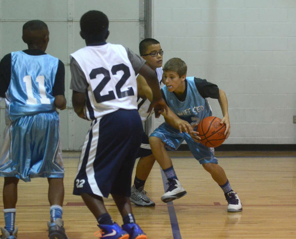 """Team """"Nuff Sed"""" of Midland (blue jerseys) and Team """" Truth"""" of Amarillo face off during the Tall City Classic Basketball Tournament last year at Midland Christian School. James Durbin/Reporter-Telegram"""