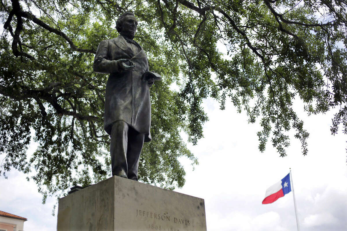 FILE - In this May 5, 2015 file photo, a statue of Jefferson Davis is seen on the University of Texas campus in Austin, Texas. The president of the University of Texas has ordered removing the statue of Davis from the center of campus, but statues of other Confederate figures will stay. The Davis statue has been targeted by vandals and had come under increasing criticism. (AP Photo/Eric Gay, file)