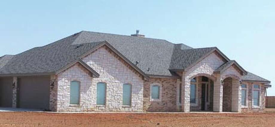 A home just like this one will be ready for you this fall in Champion's Run, a gated community two miles east of Greenwood High School. Call Monty Wheeler of WBC Custom Homes at 432-638-5227 to learn more about this home and Champion's Run.