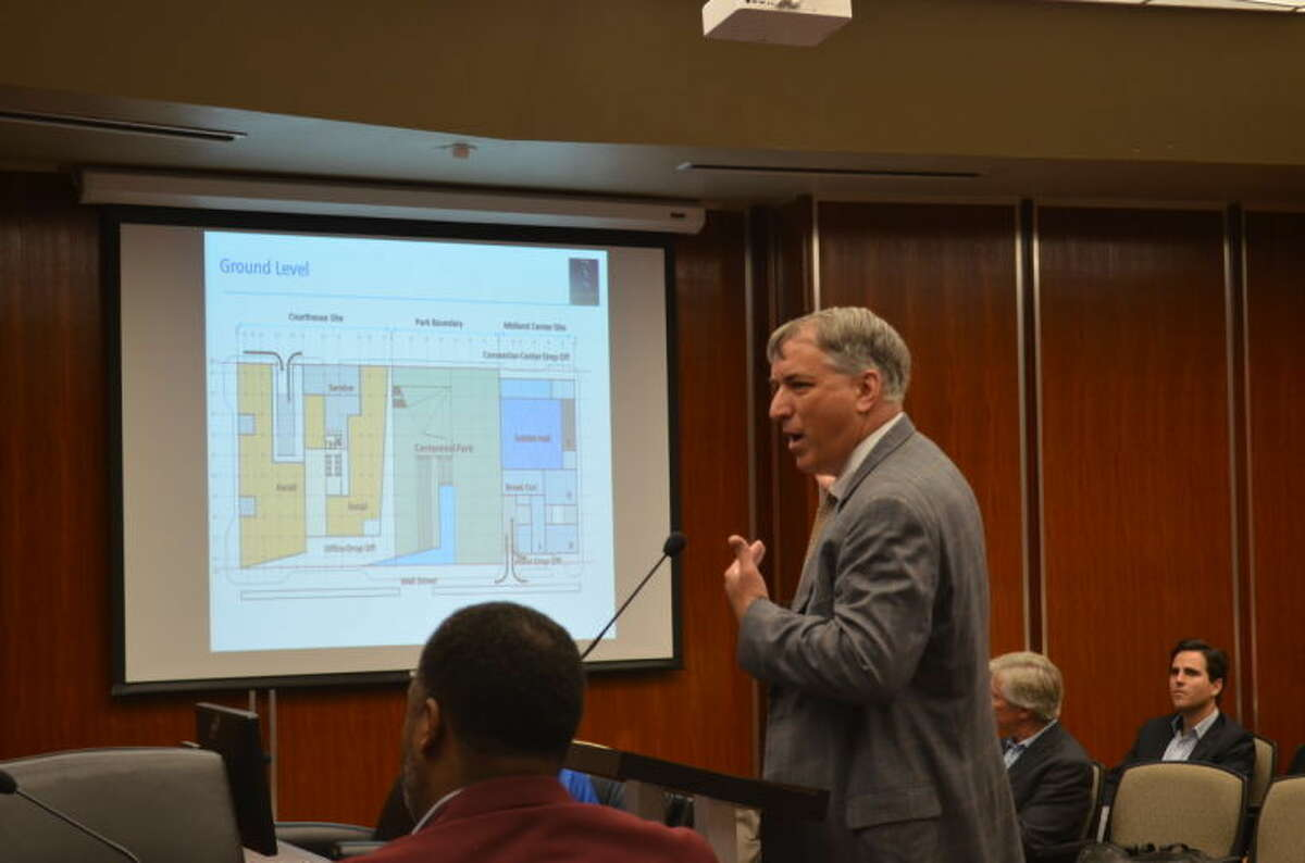 Dan Moriarity, of Edmonds International, present new Energy Towers plans to the city council during a special session Tuesday morning.