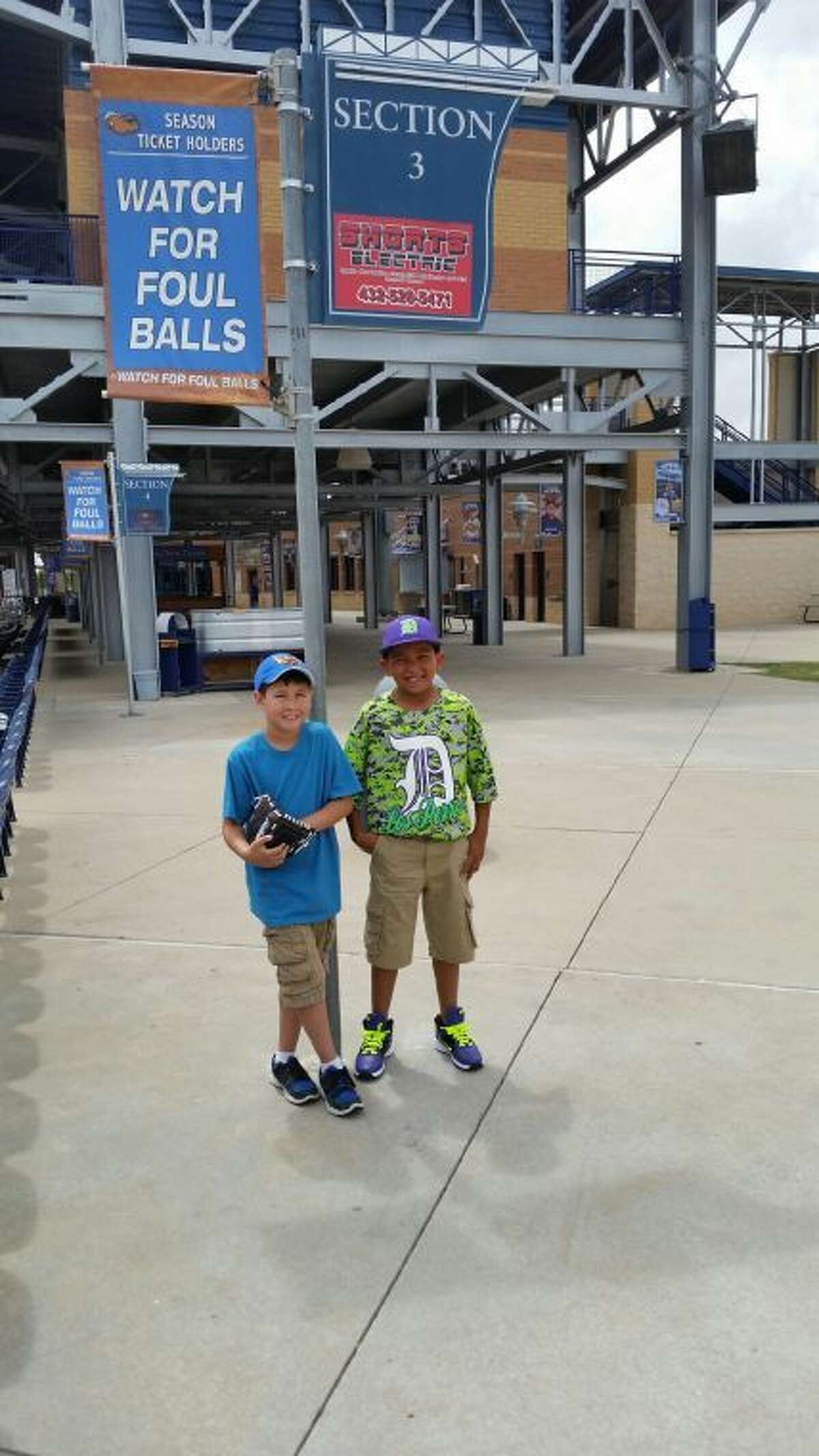 Nicolas Pettit and A.D. Navarro Jr. pose for a picture at a recent RockHounds game. When Pettit was hit in the face by a foul ball, Navarro spent his own money on a souvenir ball for him.