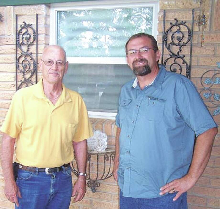 Midland homeowner Stan Sartain (left) says he and his wife really enjoy their home's insulated windows. The windows were installed by Neil Letkeman of Lifetime Windows. Call Neil at 580-8125 for a free estimate.
