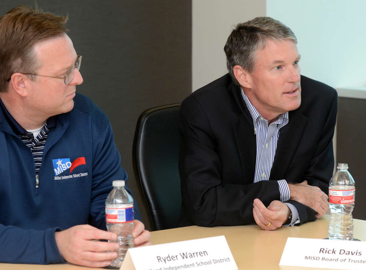 From left, Ryder Warren and Rick Davis of MISD. Midland business and community leaders meet to discuss a plan to strengthen and develop Midland's school system for the future on Dec. 18, 2014