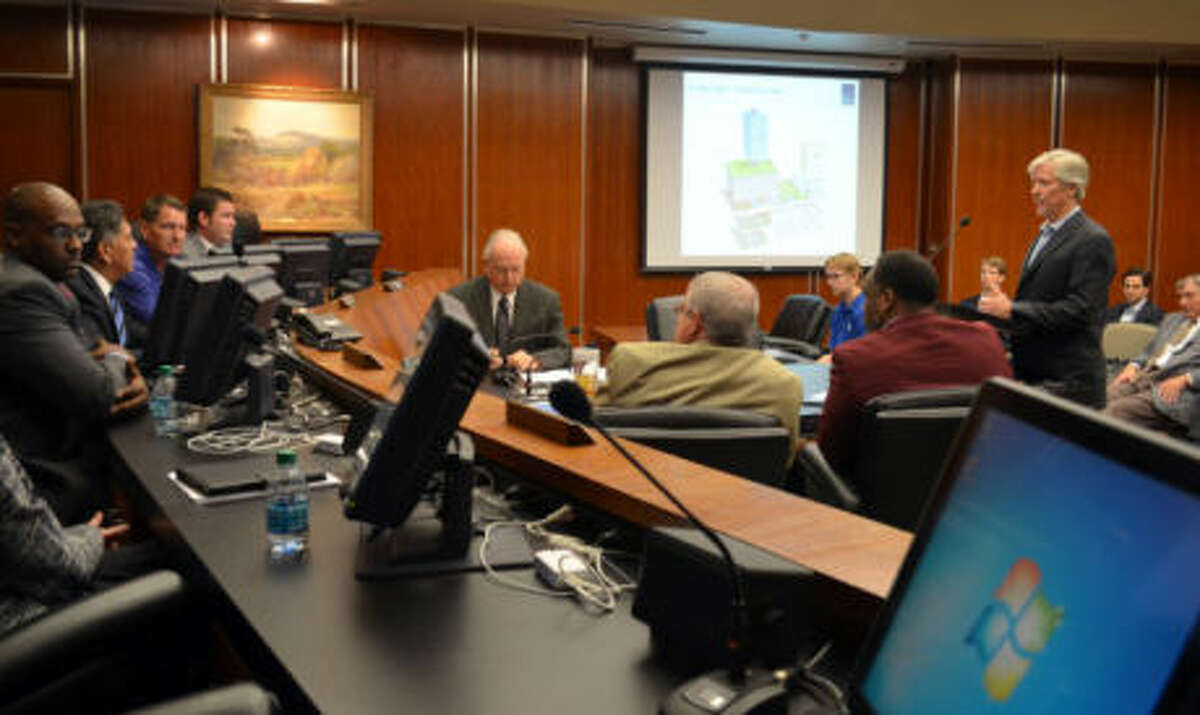 Greg Williams, vice president of development for World Class Capital Group, gives the city council an update on the Energy Towers during a special session Tuesday morning.