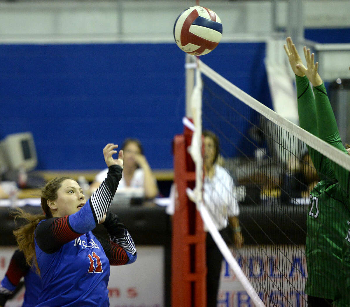 Midland Christian's Bayle Weaver (11) hits against Monahans on Tuesday, August 18, 2015, at the McGraw Events Center. James Durbin/Reporter-Telegram