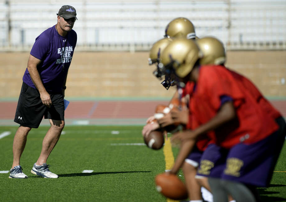 Midland High head football coach Craig Yenzer works with quarterbacks at the first team practice of the season Monday, August 10, 2015 at Memorial Stadium. James Durbin/Reporter-Telegram Photo: James Durbin