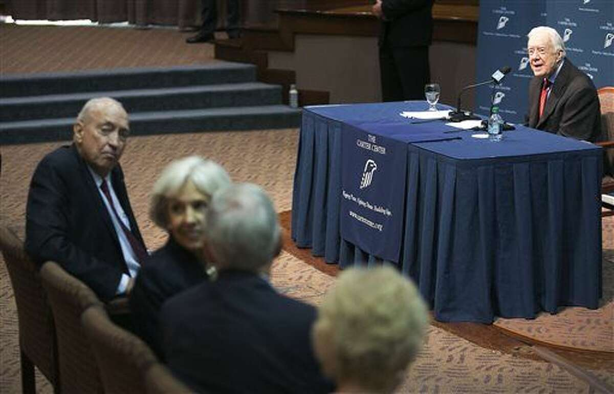 """Former President Jimmy Carter, right, discusses his cancer diagnosis during a press conference at The Carter Center in Atlanta on Thursday, Aug. 20, 2015. Carter announced Thursday that his cancer is on four small spots on his brain and he will immediately begin radiation treatment, saying he is """"at ease with whatever comes."""" (AP Photo/Phil Skinner)"""