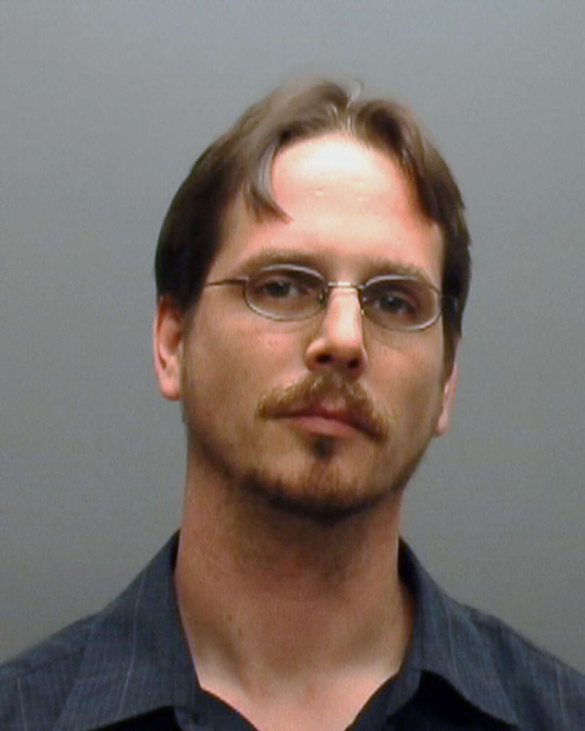 This booking photo provided by the Hays (Texas) County Sheriff shows Dane Thyssen. The Dripping Springs Police say Thyssen and his wife, Jenifer Thyssen kept their adopted son, 22-year-old Koystya Thyssen locked in a garage apartment for at least four years, periodically giving him a box of food and allowing him to leave once a week. Police began investigating when Koystya Thyssen was arrested for allegedly burglarizing a neighbor's home. (AP Photos/Hays County Sheriff)