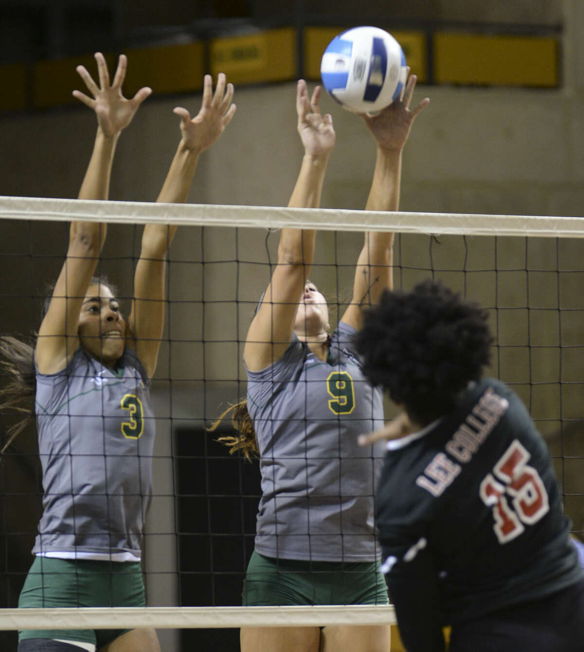 Midland College's Yahelis Villegas, 3, and Shelby Bartley, 9, go up for the block on Lee College's Alondra Bautista Friday 8-21-2015 in the Midland College Kickoff Classic at the Chaparral Center. Tim Fischer\Reporter-Telegram