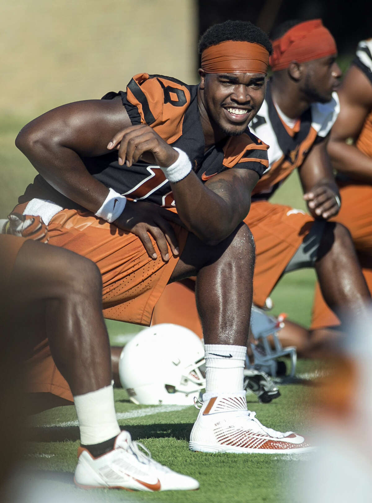 Texas quarterback Tyrone Swoops stretches with the team during NCAA college football practice in Austin, Texas, Friday, Aug. 7, 2015. (Rodolfo Gonzalez/Austin American-Statesman via AP)