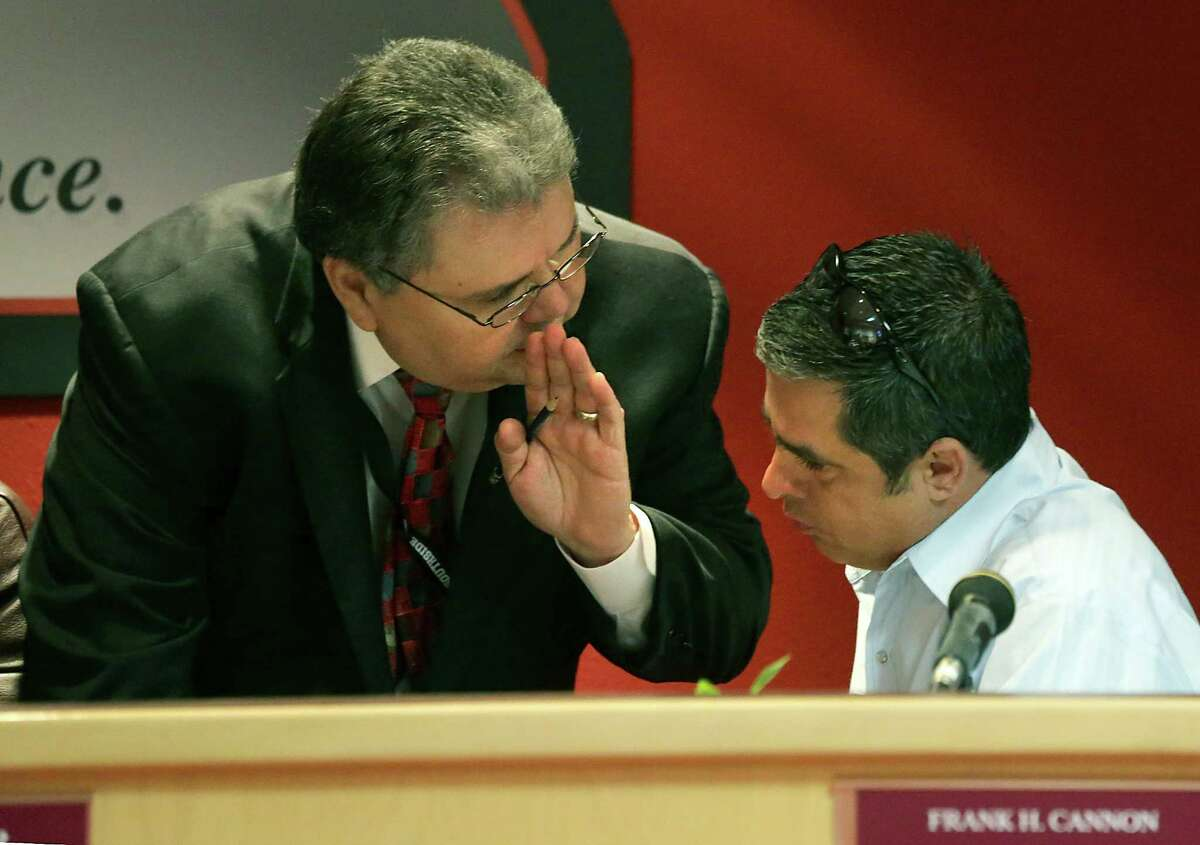 Southside ISD Superintendent Ricardo Vela, left, chats with Frank Cannon, a Board Member, Tuesday, Jan. 21, 2014.