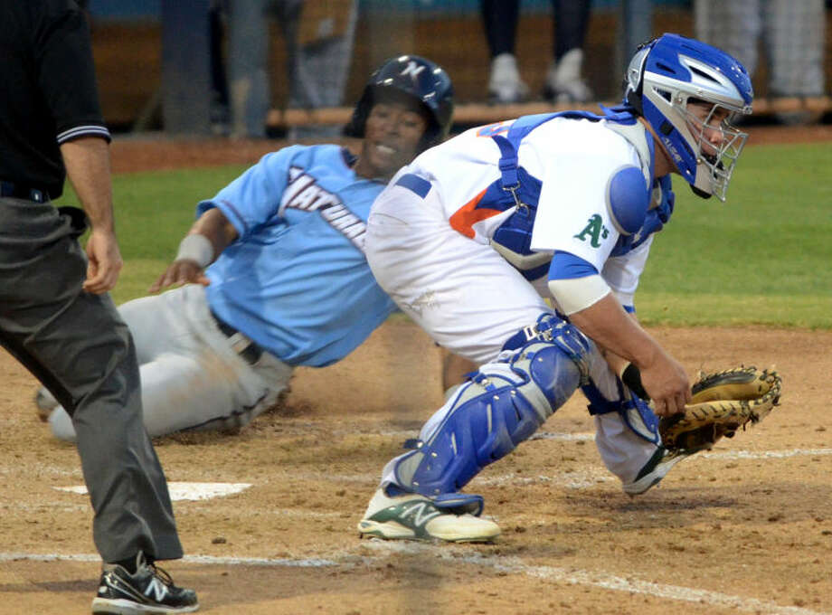 Rockhounds catcher Beau Taylor can't beat the slide from an Arkansas baserunner on Thursday at Security Bank Ballpark. James Durbin/Reporter-Telegram Photo: James Durbin