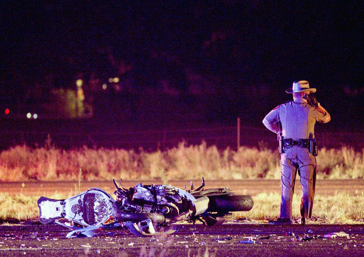 Emergency personnel work the scene of a fatal wreck involving a motorcycle on East Highway 80 at the intersection of Chukar Lane on Thursday, August 20, 2015. James Durbin/Reporter-Telegram