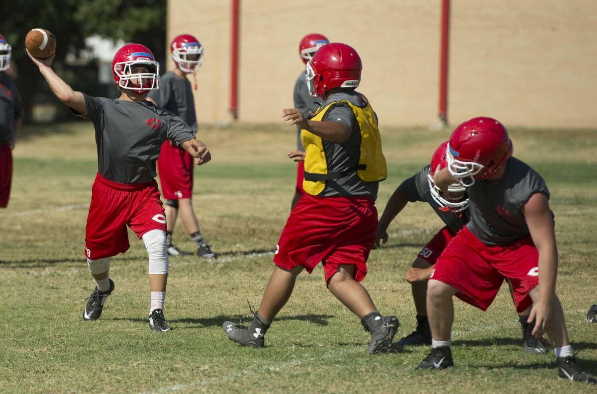 Coahoma players run drills Wednesday 8-5-15, during the first week of practice. Tim Fischer\Reporter-Telegram