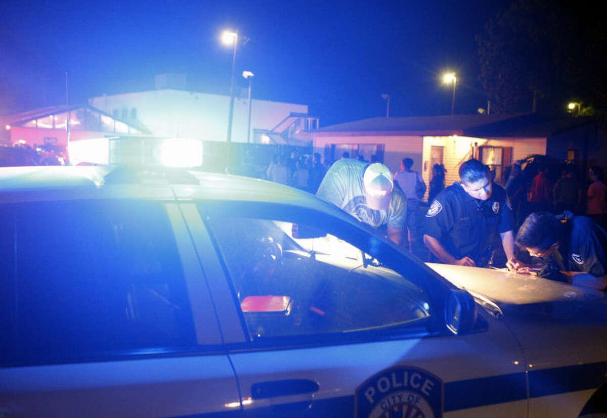 Midland emergency personnel responded to shots fired at La Bodega restaurant on N. Big Spring on Friday night. James Durbin/Reporter-Telegram