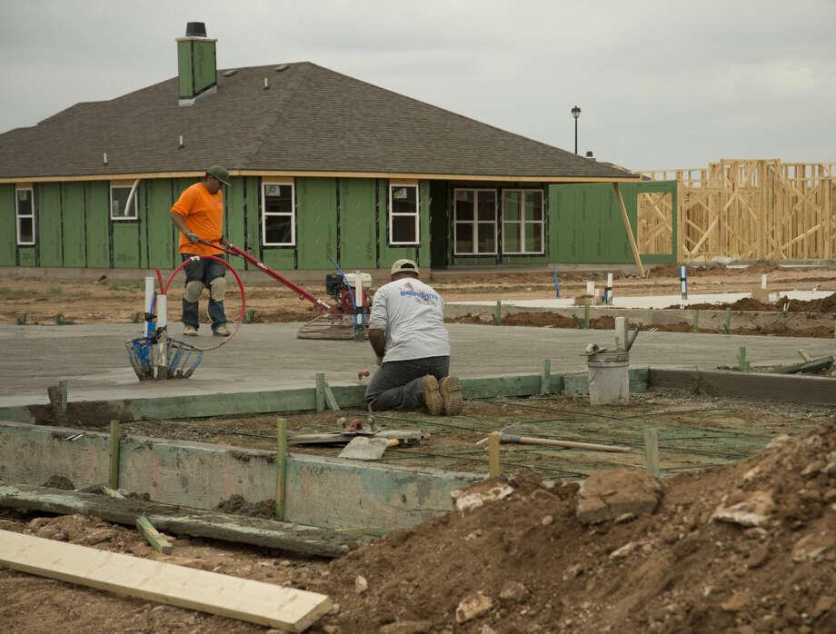 New homes being built Monday, 6-22-15, in the Lone Star Trails development off N. Big Spring Street. Tim Fischer\Reporter-Telegram Photo: Tim Fischer