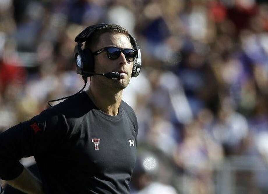 "FILE - In this Oct. 25, 2014, file photo, Texas Tech head coach Kliff Kingsbury watches play in the first half of an NCAA college football game against TCU in Fort Worth, Texas. Kingsbury calls his options at quarterback this season a ""luxury."" Sophomore Patrick Mahomes and junior Davis Webb will vie for the starting spot.(AP Photo/Tony Gutierrez, File) Photo: Tony Gutierrez/AP Photo"