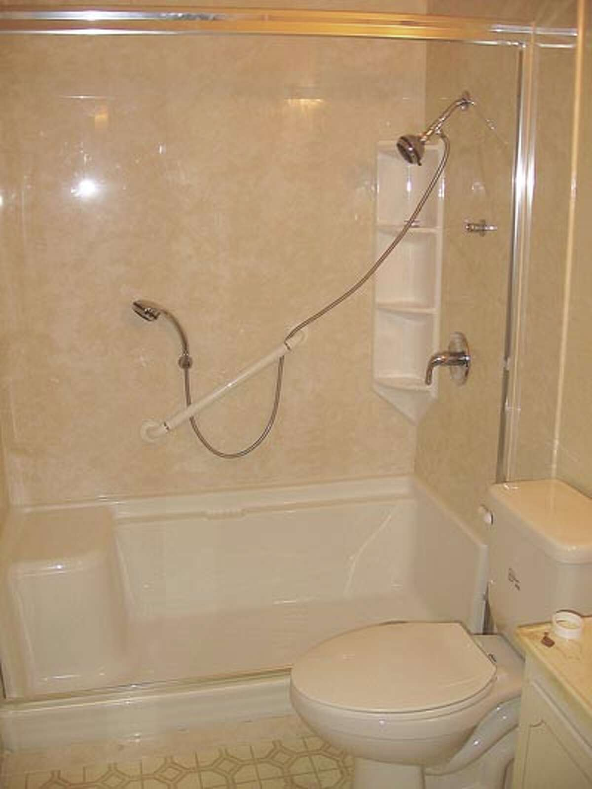 Luxury Bath's Clayton Oldham is so sold on his bath remodels he did a tub-to-shower conversion at his own grandmother's home (pictured). For a free estimate, call 218-6448.