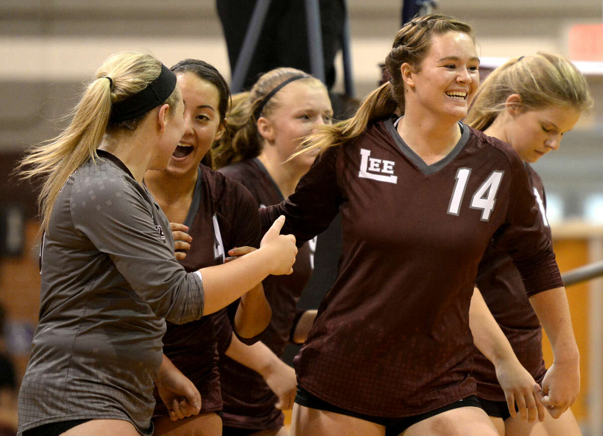 From left, Lee's Kelsey Olson (13), Shelby Olivas (4), Emily Hillman (9) and Darby O'Grady (14) celebrate after winning a match against Abilene Cooper on Tuesday, August 25, 2015, at Lee High. James Durbin/Reporter-Telegram