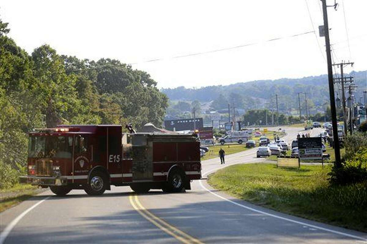Authorities block Virginia State Route 122 at Bridgewater Plaza, Wednesday, Aug. 26, 2015, in Moneta, Va., after two journalists were fatally shot while broadcasting live from the plaza earlier in the day. (Stephanie Klein-Davis/The Roanoke Times via AP)