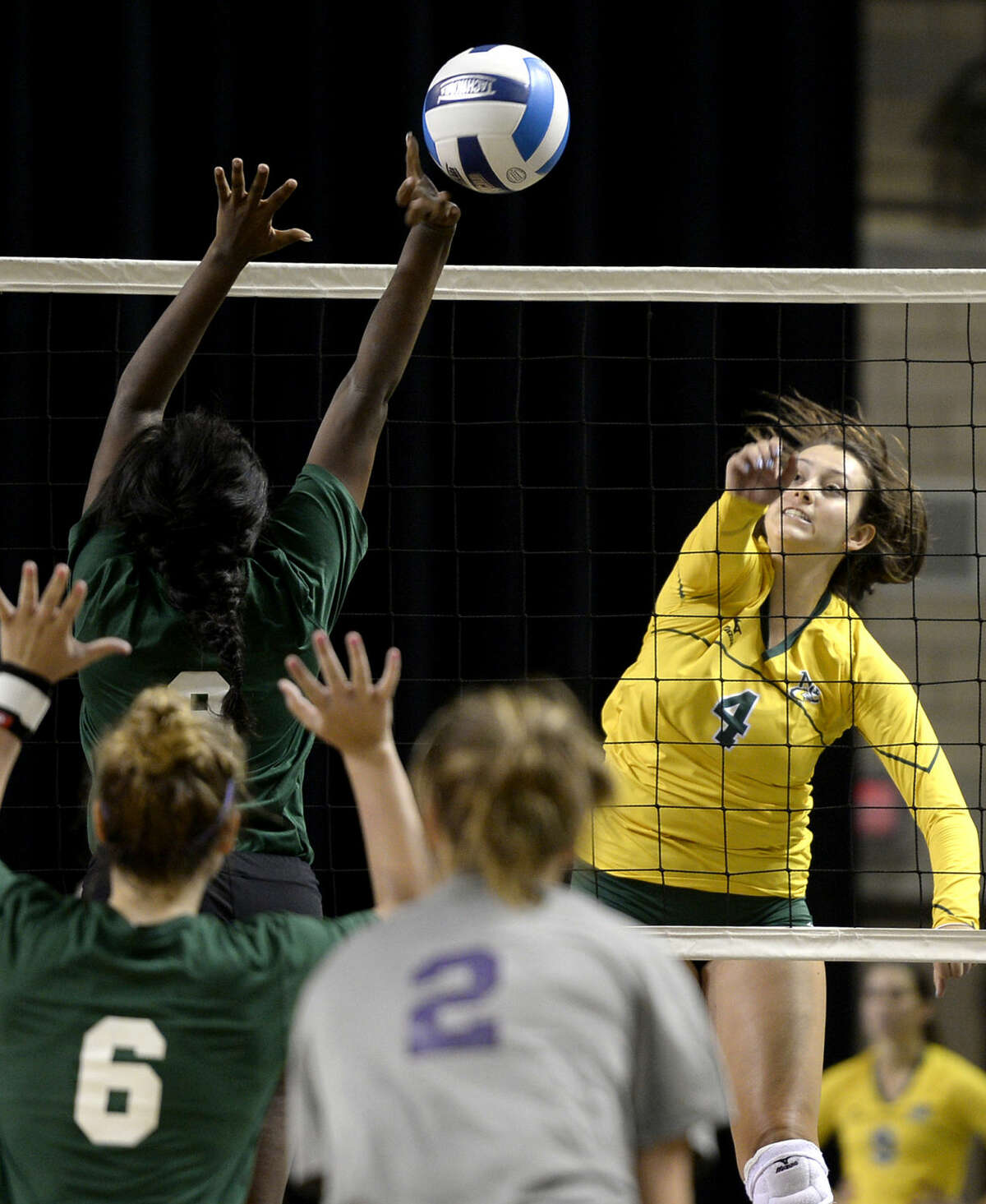 Midland College's Aleana Crow hits against Richland College on Saturday, August 22, 2015, at Chaparral Center. James Durbin/Reporter-Telegram