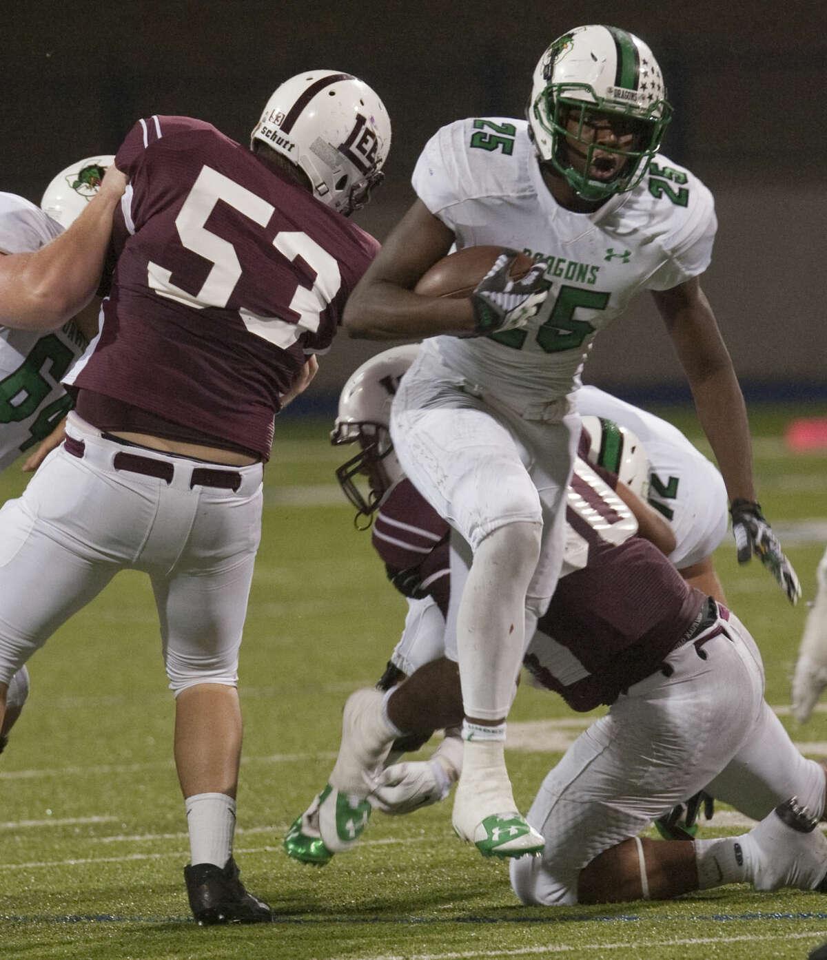 Carroll's Lil' Jordan Humphrey breaks through the Lee defensive line last season at Grande Communications Stadium. Tim Fischer\Reporter-Telegram