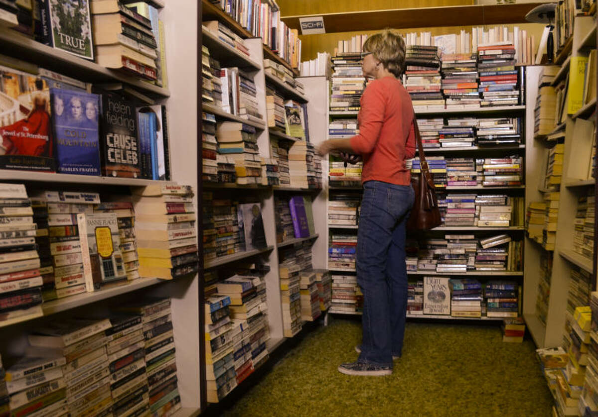 Therese Sitzman looks for books Wednesday morning at Miz B's Bookstore. Sitzman said she has bought books at the store for years after her mother first told her about it. Tim Fischer\Reporter-Telegram