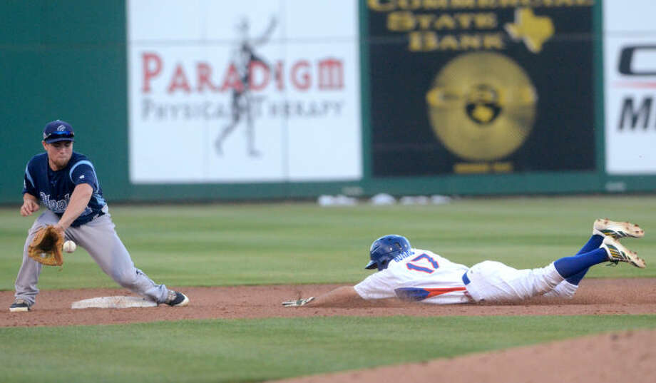 Rockhounds' Billy Burns slides into second base safe against Corpus Christi's Nolan Fontana on Thursday at Security Bank Ballpark. James Durbin/Reporter-Telegram Photo: James Durbin
